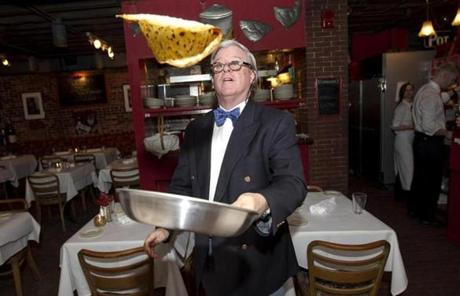 Bob Burke demonstrated how to flip a crepe at Pot au Feu.